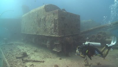 locomotive car on deck of Thistlegorm wreck with divers, Antarctica