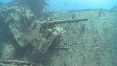 Gun emplacements on wreck of Thistlegorm with divers, Antarctica