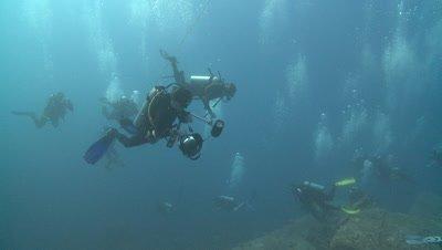 Massive number of divers (unrecognisable) over Thistlegorm wreck, Antarctica