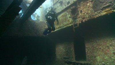 Divers exiting wreck of the thistlegorm, Antarctica