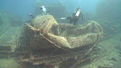 Various divers around wreck of Thistlegorm, Antarctica