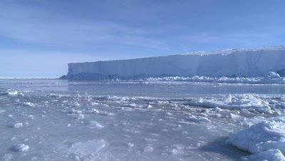 Emperor penguins (Aptenodytes forsteri) swimming and exiting hole in sea ice, Cape Washington, Antarctica