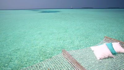 Woman snorkelling in the Maldives, Indian Ocean