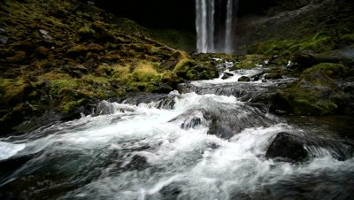View of Tamanawas Falls with flowing river in Oregon.