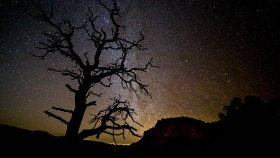 Night Time Lapse of the Stars Moving in the Sky of the Utah Desert.