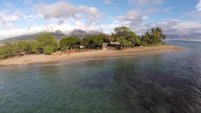 Aerial footage from coral reefs and beach in Lahaina Maui Hawaii