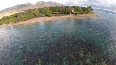Aerial footage from Baby Beach with coral reefs waves and beach in Lahaina Maui Hawaii