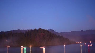 Time Lapse of stars and boats on lake during fourth of July.