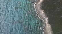 Aerial Birds Eye View Of Crashing Waves On Rocky Island Shore