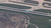 Aerial Aircraft Landing Chicago O'hare Airport Zooms Out To Full Airport View
