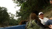 Woolly Monkey Is Fed And Petted By Happy Guides While On The Motorboat