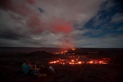 Group of people sitting and watching lava flow, Volcanoes National Park, timelapse