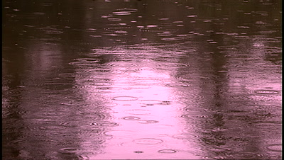 Water - Tilt Up Rain Falling On Water, Sunset Reflected In Water