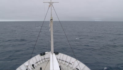 Ship bow at Ross sea with Iceberg in background