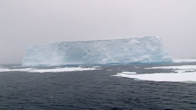 Massive Iceberg in Ross sea, while snowing