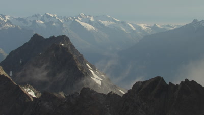 View of mountain top in foreground and full mountains in BG
