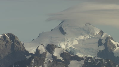 View of snowy mountains, pan left and zoom out to wider view of mountains