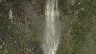 Zoom out on waterfall to reveal surrounding scenery