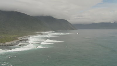Cam flies along coast as waves crash on shore