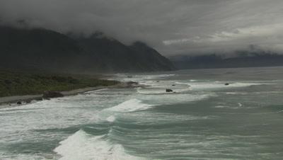 Flying along the shore as waves crash