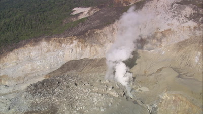 circling and zoom in on Sulphur Spring with plumes of smoke obscuring the view