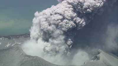 Scenic view of an island volcano erupting with volcanic ash