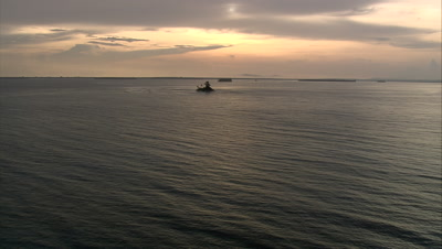Approaching small island at sunset