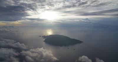 Very high aerial, gradually approaching Cocos Island
