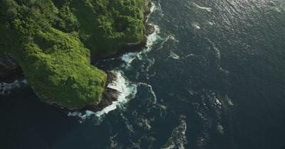 Bird's eye view, tracking along coast of Cocos Island