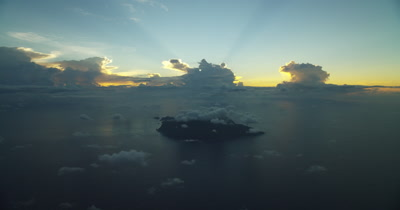 Looking through clouds to island in the distance. Beautiful sunrise/sunset in BG