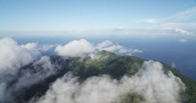 Flying over cloud covered island