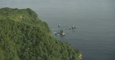 circling rock formations near island coast
