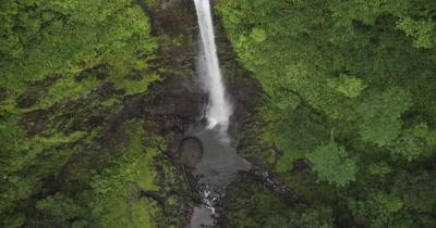 bird's eye view of waterfall, tracking upwards