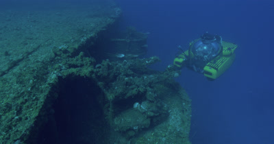 submarine approaches turret mounted guns on the USS Saratoga