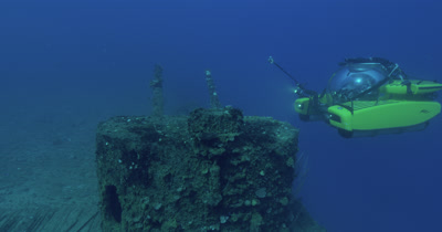 Traveling along wreck USS Saratoga, tilt up to guns and submarine