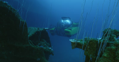 Tracking submarine while it surveys wreck. Wreck in foreground.