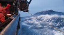 Crab Fishing Bering Sea Alaska - Fisherman Throws Hook And Runs Bouys Through Block