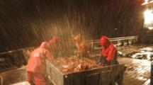 Crab Fishing Bering Sea - Fishermen Sort Crab On Icy Deck, Spray Over Camera