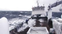 Crab Fishing Bering Sea - Fishermen Work Hard Beating Ice From Boat In Rough Sea, Dark Inky Water, Waves