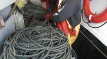 men attach bait to hooks, longlining for halibut and black cod alaska