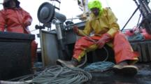 Man On Fishing Boat Coils Line As It Comes On Board, Longlining For Halibut And Black Cod Alaska