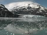 Glacier Reflected In Icy Ocean