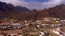 Aerial Over Cabo San Lucas Toward Mountains, Sea Of Cortez In Distance