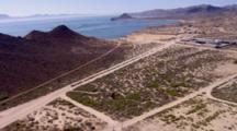 Aerial Over Coastal Resort Community, Small Airport, Toward Ocean