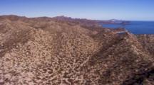 Aerial Over Desert Mountains Toward Shore Of Sea Of Cortez