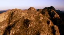Aerial Over Desert Mountains Toward Sea