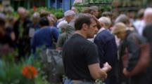 Shoppers And Vendors At Columbia Road Flower Mart