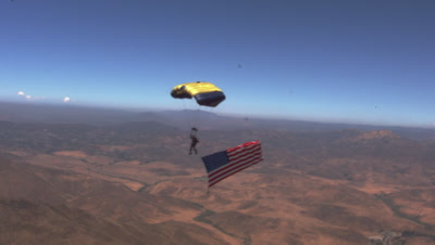 Navy Seal Sky Dives With Flag And Smoke Trail
