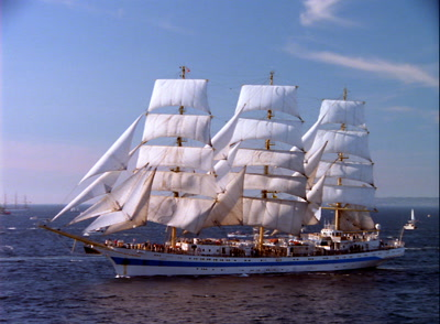 Historic Tall Ship Sails Near Harbor