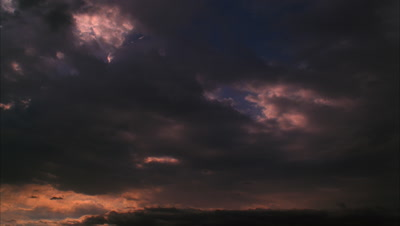 Timelapse Of Storm Clouds Moving Across Dark Sky